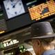 Unrecognizable traveler with hat waiting train departure, travel concept - PhotoDune Item for Sale