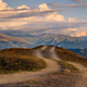 Mountain landscape view with curvy road and colorful sunset clouds, Svaneti, Georgia - PhotoDune Item for Sale