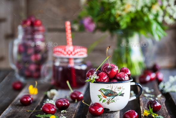 Fresh wet cherry in enamel metal mug - Stock Photo - Images