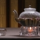 Beautiful Warm Picture of Transparent Teapot Kettle with Tasty Green Black Tea on a Table  - VideoHive Item for Sale