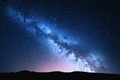 Milky Way and pink light at mountains. Night colorful landscape. - PhotoDune Item for Sale