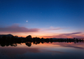 Mountain lake with stars and reflected clouds in water. Night - PhotoDune Item for Sale