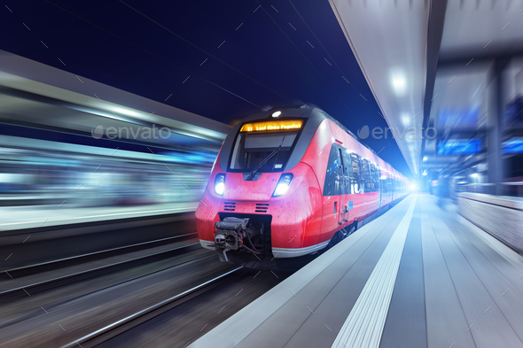 Modern high speed red passenger train at night - Stock Photo - Images