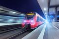 Modern high speed red passenger train at night - PhotoDune Item for Sale