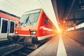 Modern high speed red commuter train at colorful sunset - PhotoDune Item for Sale