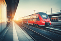 Railway station with beautiful modern red commuter train at suns - PhotoDune Item for Sale