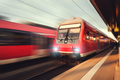 Beautiful railway station with modern red commuter train at suns - PhotoDune Item for Sale