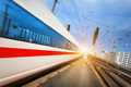 High speed passenger train on tracks in motion at sunset - PhotoDune Item for Sale