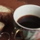 Butter on a Piece Rural Bread and Cup of Coffee on a Wooden Old Table - VideoHive Item for Sale
