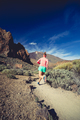 Trail running girl in mountains, inspiration and motivation