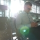 Young Businessman Sitting at Airport and Using Smartphone with Sun Flare at Background.  Portrait - VideoHive Item for Sale