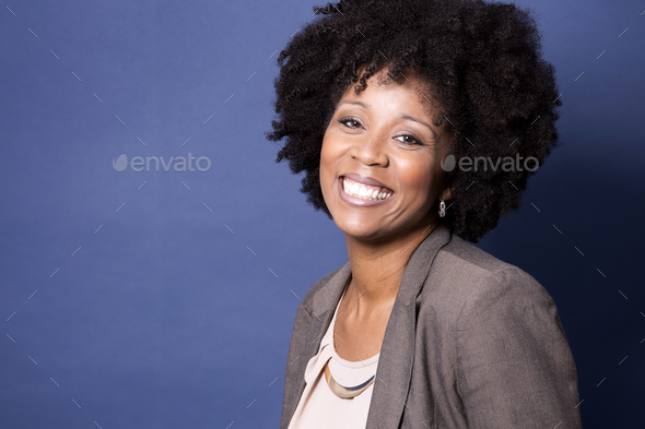 black casual woman on blue background - Stock Photo - Images