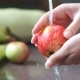 Washing an Apple in the Kitchen, Human Hands Holding a Fresh Apple.