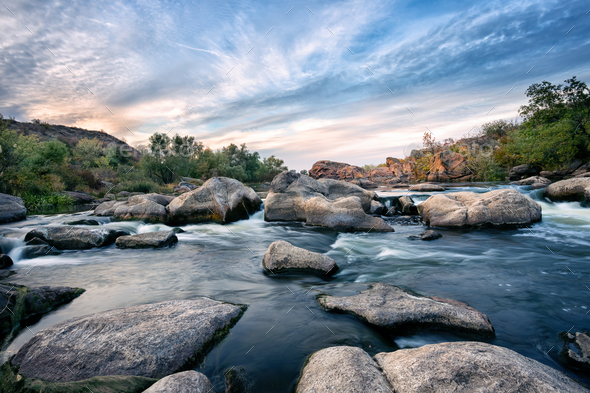 Roll on a mountain river among the stones - Stock Photo - Images