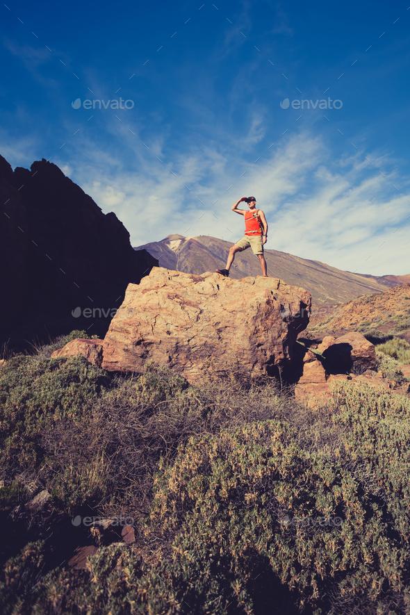 Man celebrating inspiring mountains view - Stock Photo - Images