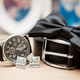 Shirt buttons, belt, watch and bow on a table - PhotoDune Item for Sale