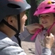 Dad Puts Safety Helmet on Is Little Daughter's Head - VideoHive Item for Sale
