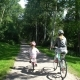 Mom and Daughter Ride Bicycles in the Park - VideoHive Item for Sale
