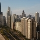 Aerial View of the Beautiful Chicago Cityscape, Flying Away From Skyscrapers and Michigan - VideoHive Item for Sale