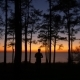 Silhouettes of People at Sunset Trees and Sea