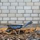 Old rusty wheelbarrow in construction site - PhotoDune Item for Sale