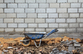 Old rusty wheelbarrow in construction site - PhotoDune Item for Sale