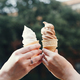 Two Hands Holding Ice Cream Cones - PhotoDune Item for Sale