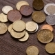 Euro Coins and Bitcoins Are Falling on the Table