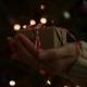 Hand Holding Christmas Gift Box