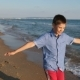 Boy Runs Along the Beach - VideoHive Item for Sale