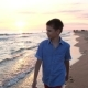 Boy Walk Along the Beach - VideoHive Item for Sale