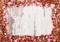 Frame of dried wild rose petals and tea grains, copy space for text
