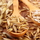 Heap of organic oat grains and oatmeal on wooden spoon, healthy nutrition concept - PhotoDune Item for Sale