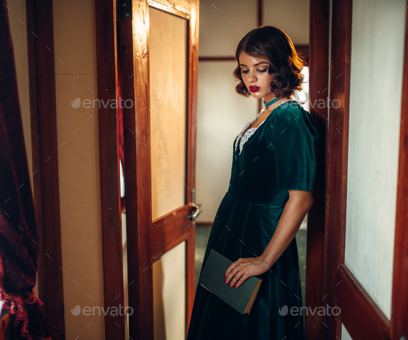 Young woman travels, vintage train compartment - Stock Photo - Images