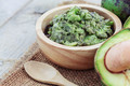 Grated avocado in bowl on sackcloth