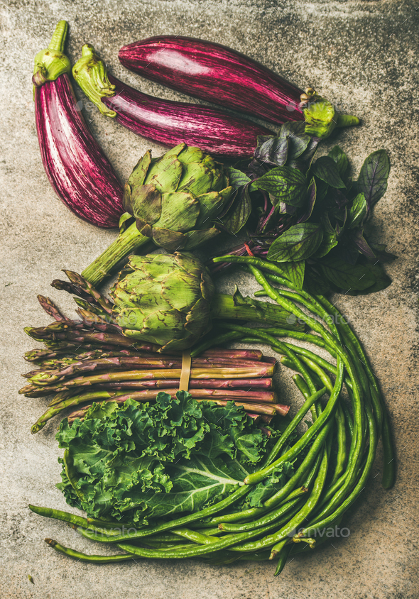 Flat-lay of fresh green and purple vegetables - Stock Photo - Images