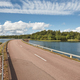 Finnish landscape with road, lake and forest island. Finland. Europe - PhotoDune Item for Sale