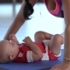 Shooting As a Mother During Push-ups on a Mat for Yoga Kisses a Child - VideoHive Item for Sale