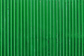 old green painted metal ribbed surface