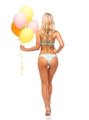 woman in bikini swimsuit with air balloons