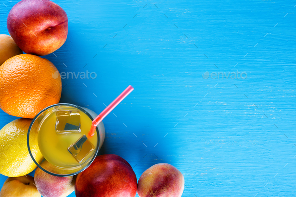 Fresh tropical fruits and a glass of juice with ice - Stock Photo - Images