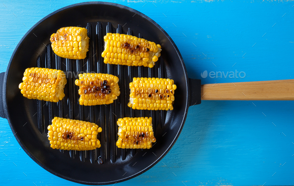 Baked corn in a frying pan - Stock Photo - Images