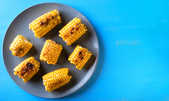 Gray plate with baked corn - Stock Photo - Images