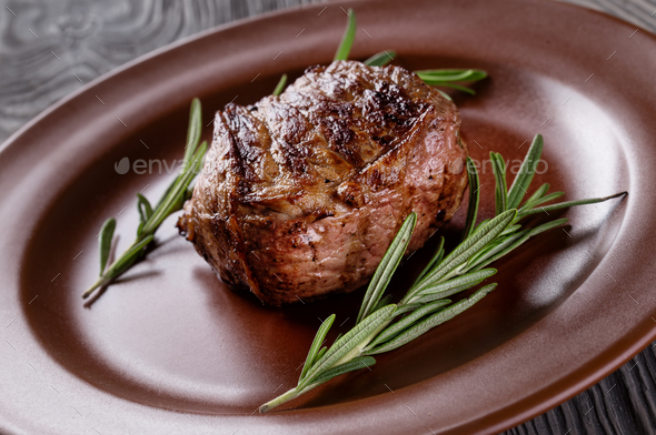 Fried meat on a plate with rosemary - Stock Photo - Images