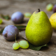 fruit grapes plum pear on wooden background - PhotoDune Item for Sale
