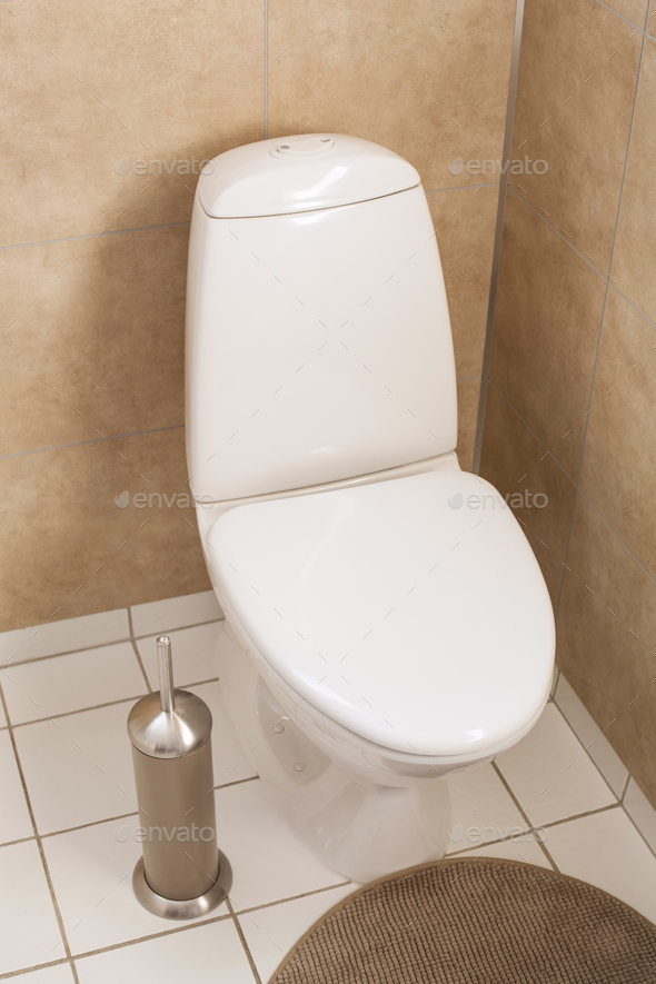White Toilet Bowl In Modern Bathroom Stock Photo By Duskbabe Photodune - Modern-bathroom-toilet