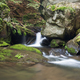 Stone guardian of the waterfalls - bizarre boulder on the bank - PhotoDune Item for Sale