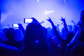Crowd of people using smart phones to photographing a concert
