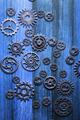 steampunk mechanical cogs gears wheels on blue background