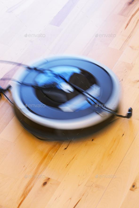 robotic vacuum cleaner on laminate wood floor smart cleaning tec - Stock Photo - Images